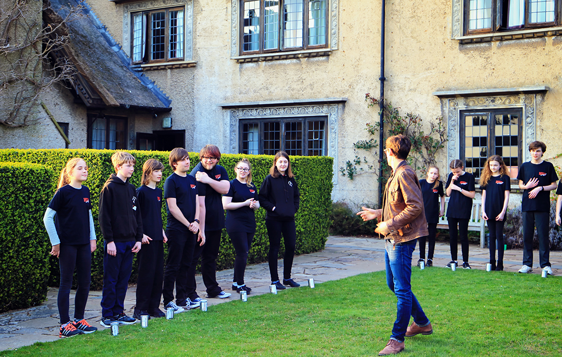 Conducting the Keyboard Camp 'Rain Choir' performance, outdoors in the sunshine! (Photo: Will Jones)